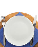 Plate, knife and fork  at cutting board Royalty Free Stock Images