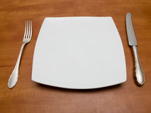 Plate, knife and fork Stock Photos