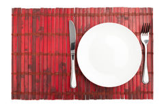 Plate, knife and fork isolated on white Stock Image