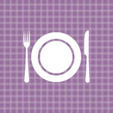 Plate knife and fork on lilac tablecloth Stock Photos