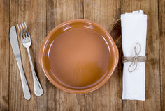 Plate, knife and fork at napkin Royalty Free Stock Photo