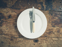 Plate with knife and fork Stock Image