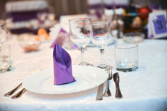 Plate, knife, fork and purple napkin Royalty Free Stock Images