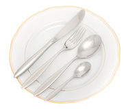 Plate with knife, fork and spoon Stock Photos