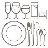 Plate, knife, fork, spoon and drinking glasses Royalty Free Stock Image