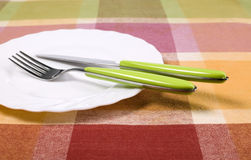 Plate with knife and fork on the table Stock Image
