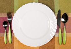 Plate with knife and fork on the table Royalty Free Stock Photography