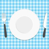 Plate knife and fork on tablecloth. White plate, knife and fork on blue tablecloth. Place for dinner, restaurant or cafe concept. Vector illustration in modern Royalty Free Stock Image