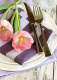 Plate, knife, fork and tulips Royalty Free Stock Photo