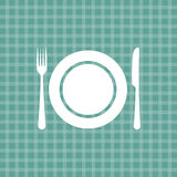 Plate knife and fork on turquoise tablecloth Royalty Free Stock Photo