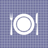 Plate, knife and fork on violet checkered tablecloth. Plate, knife and fork on violet picnic checkered tablecloth Stock Photography