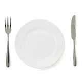 Plate, knife and fork on white Royalty Free Stock Photos