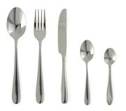 Plate, knife and fork on white. Background Stock Photos