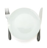 Plate, knife and fork  on white Stock Photos
