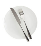 Plate, knife and fork  on white. Plate, knife and fork on white background Royalty Free Stock Photo