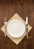 Plate, knife and fork  on wood Stock Image