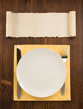 Plate, knife and fork  on wood Stock Photos