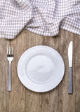 Plate, knife and fork Stock Images