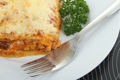 Plate of lasagna Stock Photography