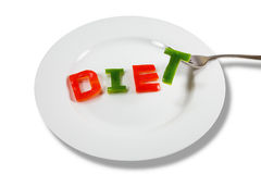 Plate with letters. Close-up of plate with letters cut out of red and green peppers Stock Photo