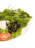 A plate of lettuce, feta, black olives Royalty Free Stock Photo