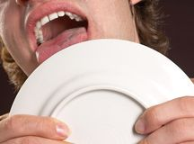 Plate licking stock photos