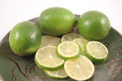 Plate of Limes Isolated Royalty Free Stock Photography