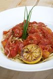 Plate of linguine with tomato sauce Royalty Free Stock Images