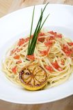 Plate of linguine topped with diced tomatos Royalty Free Stock Photography