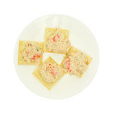 Plate of lobster dip on saltine crackers on white background Royalty Free Stock Photo