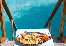 Plate with lobster  with kind on ocean Royalty Free Stock Photo