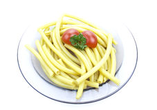 Plate of macaroni. With parsley and  tomato isolated Royalty Free Stock Images