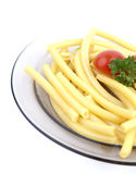 A plate of macaroni. With parsley and  tomato isolated Royalty Free Stock Images