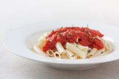 Plate of macaroni with tomato sauce Royalty Free Stock Photos