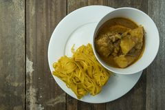 Roti Jala with a bowl of chicken curry royalty free stock photography