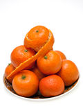 Plate with mandarins. An isolated photo of mandarins stowed to heap on a plate Stock Image