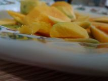 A plate of mango. Fruit on plate ready to serve Royalty Free Stock Image