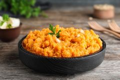 Plate with mashed sweet potatoes on table. Plate with mashed sweet potatoes on wooden table royalty free stock photos