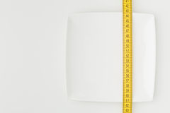 Plate and Measurement Tape - Dieting Stock Image
