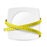 Plate with measuring tape. Diet theme Stock Photos