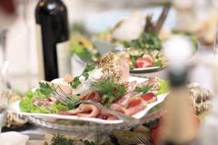 Plate with meat appetizer on the table in the restaurant stock image