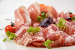 Plate of meat. Traditional Inalian food. Allsorts of jamon, Coppa Royalty Free Stock Photo