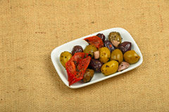 Plate of Mediterranean snack of olives mix on canvas Royalty Free Stock Images