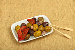 Plate of Mediterranean snack of olives mix on canvas Royalty Free Stock Photos