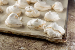Plate with meringues Stock Images