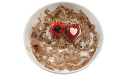 A plate of messy chocolate mousse with strawberrie Royalty Free Stock Images