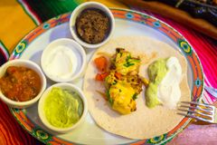Plate of mexican chicken fajitas. With dips Royalty Free Stock Photos