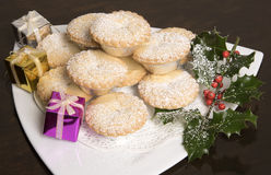 A plate of Mince pies with Holly and berries Stock Photo