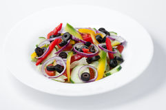 Plate with mixed raw cut-up vegetables Stock Photo
