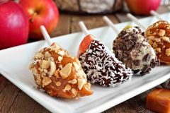 Plate of mixed sweet caramel and chocolate dipped apple slices Stock Photo